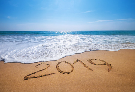 Foto de Happy New Year 2019 is coming concept sandy tropical ocean beach lettering concept image and - Imagen libre de derechos