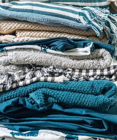 Foto de Close-up image of  folded home textile. Home work concept image. - Imagen libre de derechos