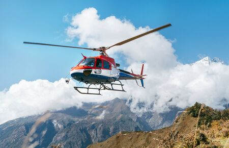 Foto de Medical Rescue helicopter landing in high altitude Himalayas mountains. Safety and travel insurance concept image. - Imagen libre de derechos
