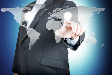 Business man pointing on the touch screen with world map  Concept for connectivity