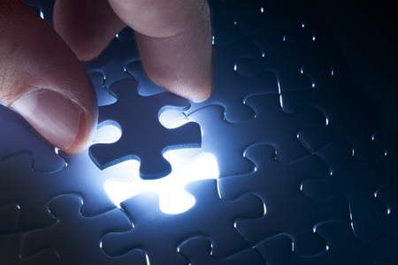 Photo pour Missing jigsaw puzzle piece with light glow, business concept for completing the final puzzle piece - image libre de droit