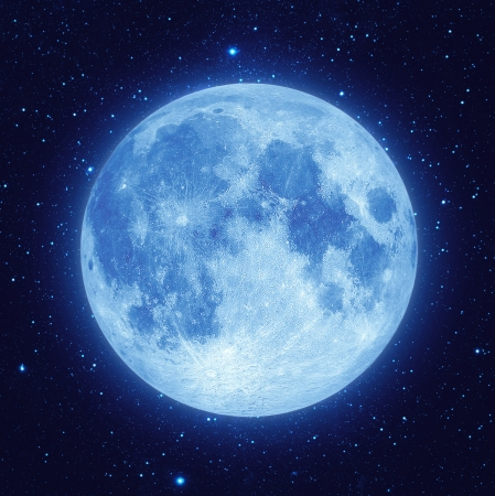 Foto de Full blue moon with star at dark night sky background - Imagen libre de derechos