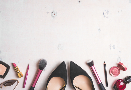 Foto de Feminine cosmetic background. Overhead of essentials of a modern woman. Cosmetic objects frame. Instagram filter style - Imagen libre de derechos