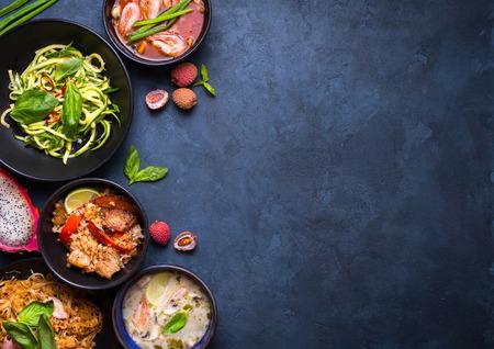 Photo for Thai food background. Dishes of thai cuisine. Tom yum, tom kha gai, pad thai noodles, thai fried rice with pork and vegetables khao phat mu, green papaya salad som tam, thai fruits. Space for text - Royalty Free Image