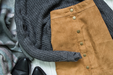 Foto de Brown skirt and gray sweater. Fashionable concept - Imagen libre de derechos