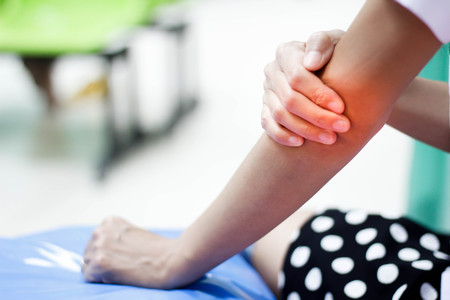 Photo pour Woman suffering from an elbow injury - image libre de droit
