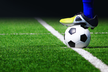 Photo pour Soccer ball on field in stadium - image libre de droit