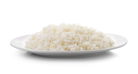 Foto de Cooked rice in a white plate on white background - Imagen libre de derechos