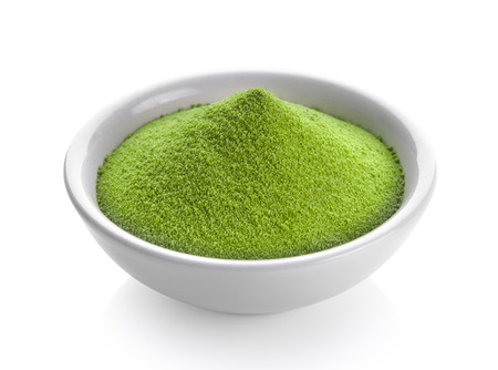 Photo for green tea powder in a bowl on white background - Royalty Free Image