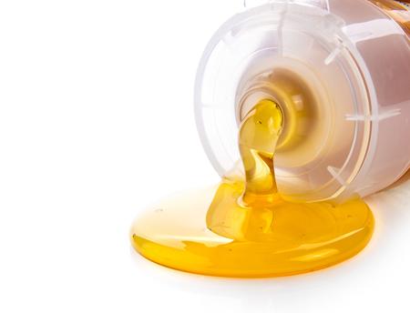 Foto de honey in plastic tube isolated on white background - Imagen libre de derechos