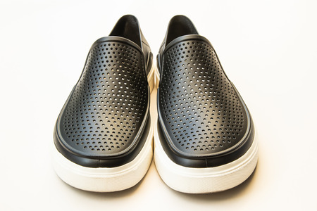 Foto de Men's fashion black rubber shoes, Casual design isolated on white - Imagen libre de derechos