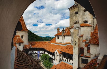 Photo for Bran, Romania - September 7, 2017: View of inside part of Bran or Dracula Castle in Transylvania, Romania. Tower of medieval Bran Castleor under a cloudy sky - Royalty Free Image