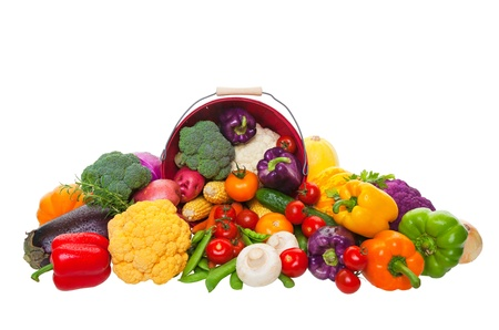 A farmers market display of fresh vegetables with a red bushel basket.  Shot on white background.