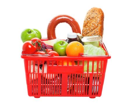 A grocery basket filled with fresh fruits, vegetables, sausage, bread, and canned goods   Shot on white background