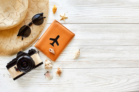Photo pour summer travel vacation concept flat lay, space for text. photo camera passport plane hat  and sunglasses and shells on white wooden background top view. hello summer. wanderlust - image libre de droit