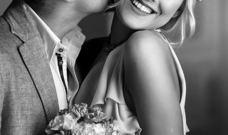 Photo pour luxury bride in vintage dress and groom embracing and smiling at window in morning light in hotel room. happy wedding couple, sensual romantic moment, black white photo - image libre de droit