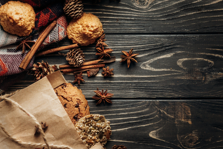 Photo for cookies cupcakes and spices on wooden background, stylish rustic winter flat lay. space for text. cozy mood autumn. seasonal holidays bakery concept - Royalty Free Image