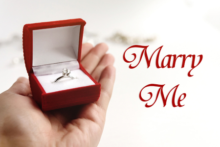 Photo pour luxury ring in hand, will you marry me text, greeting card concept - image libre de droit