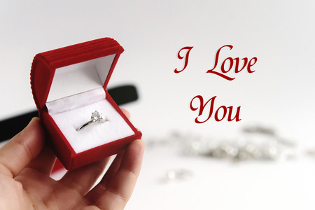 Photo pour luxury ring in hand, i love you text, greeting card concept - image libre de droit