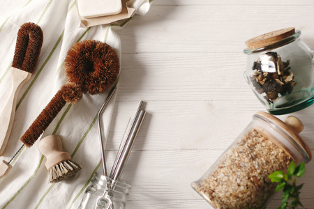 Photo for sustainable lifestyle concept. zero waste. eco natural coconut soap and brushes for washing dishes, metal straws, granola in glass, eco friendly flat lay. plastic free items.  reuse, reduce - Royalty Free Image