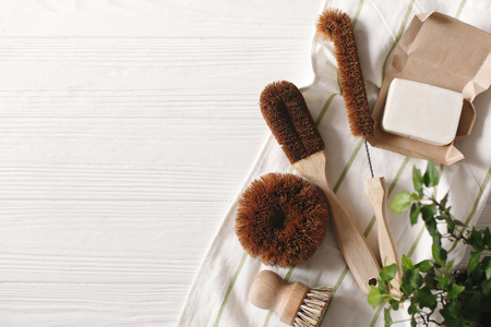 Photo for eco natural coconut soap and brushes for washing dishes, eco friendly flat lay. sustainable lifestyle concept. zero waste food cleaning. plastic free items. reuse, reduce, recycle - Royalty Free Image