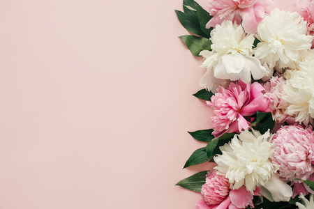 Photo for International Womens Day. Stylish peonies flat lay. Pink and white peonies border on pastel pink paper with space for text. Happy mothers day, floral greeting card mockup. Valentines day. - Royalty Free Image