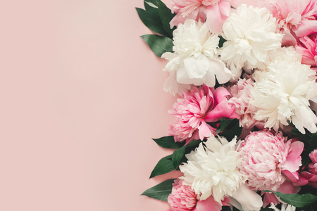 Photo for Happy mother's day. International womens day. Greeting card mockup. Stylish pink and white peonies  border on pink paper flat lay with space for text. - Royalty Free Image