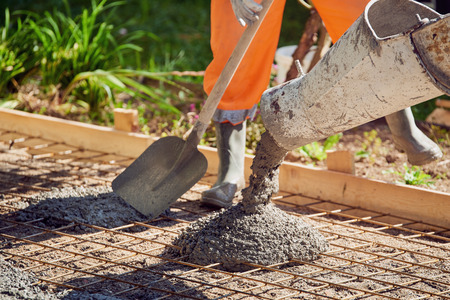Photo for Concrete pouring during commercial concreting floors of building - Royalty Free Image