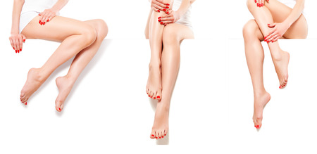 Foto de Three beautiful slim female legs with red manicure, isolated on white background - Imagen libre de derechos