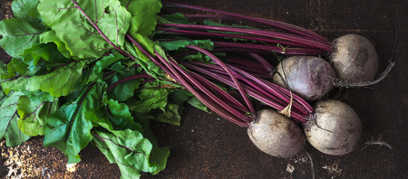 Photo for Bunch of fresh garden beetroot over grunge rusty metal backdrop, top view - Royalty Free Image