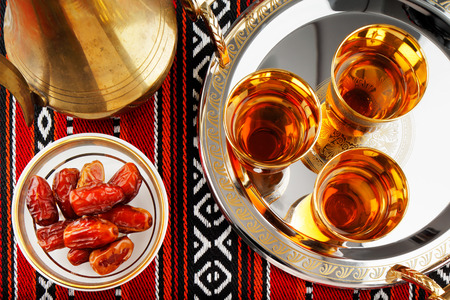Iconic Abrian fabric is graced with symbols of Arabia, in particular Arabic tea and dates, they symbolise Arabian hospitality.