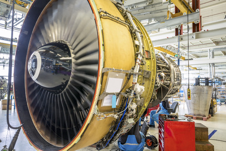 Photo for An airplane engine during maintenance in a warehouse - Royalty Free Image