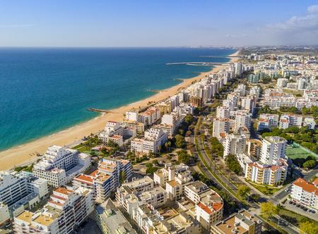 Foto per Wide sandy beach in touristic resorts of Quarteira and Vilamoura, Algarve, Portugal - Immagine Royalty Free