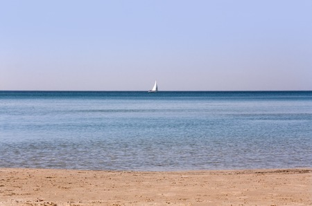 Photo for morning seascape with sailboat on the horizon as background - Royalty Free Image