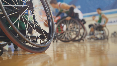 Foto de Handicapped basketball player in a wheelchair during sportive training - Imagen libre de derechos