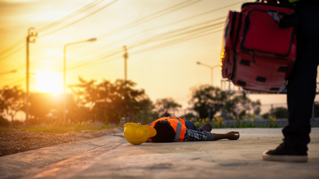 Photo pour Accident at work of construction labor people, Basic First aid and CPR Training at outdoor. Heat Stroke or Heat exhaustion in body concept. - image libre de droit
