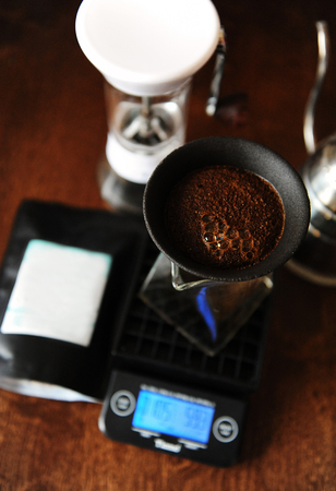 Photo for Coffee blooming in porous ceramic paperless dripper filter. Alternative manual brewing. Gooseneck kettle. Electronic scales, manual coffee grinder - Royalty Free Image