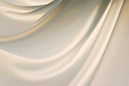 a light soft nylon cloth is gently draped creating folds in this back lit image.