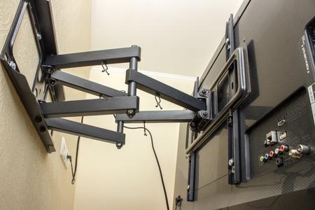Foto de TV bracket LED display. Swivel bracket for TV. - Imagen libre de derechos