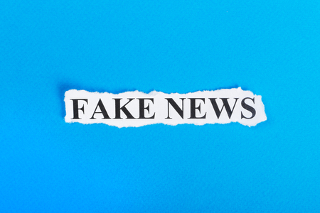 Photo for FAKE NEWS text on paper. Word FAKE NEWS on torn paper. Concept Image. - Royalty Free Image
