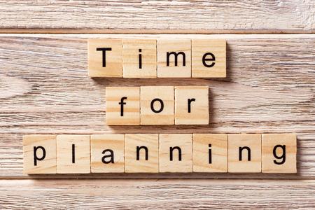 Foto de Time for planning word written on wood block. Time for planning text on table, concept. - Imagen libre de derechos