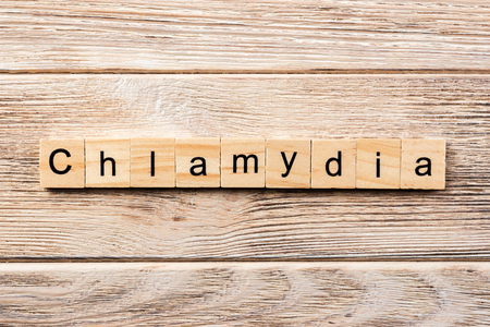 Photo for chlamydia word written on wood block. chlamydia text on table, concept. - Royalty Free Image