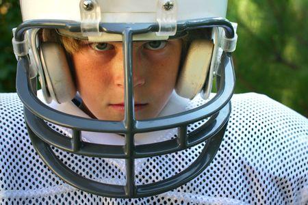 young boy in football uniform