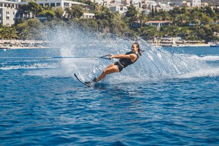 Photo pour Water skis glides on the waves - image libre de droit