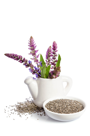 Photo pour Chia seeds healthy superfood with flower isolated on white background - image libre de droit