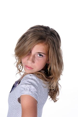 tween girl standing sideways and looking into camera