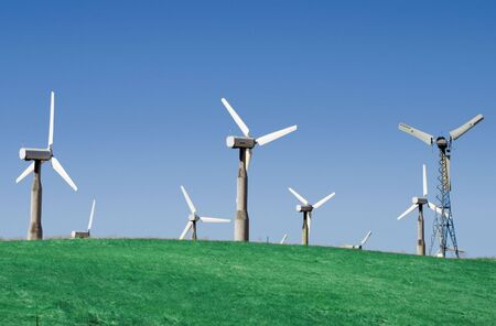A group of windmills on rolling hills in California.