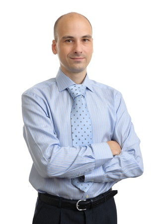 Photo pour Portrait of young business man with folded hands over white background - image libre de droit
