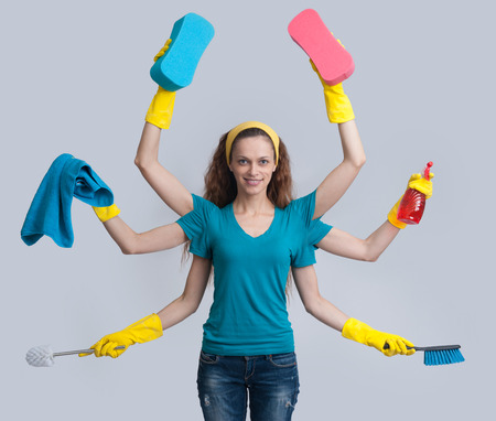 Photo pour housewife with six hands multitasking her cleaning. Isolated on gray - image libre de droit