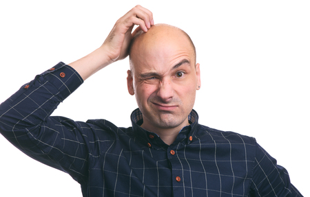 Photo pour Confused bald guy scratch his head. Isolated on white - image libre de droit